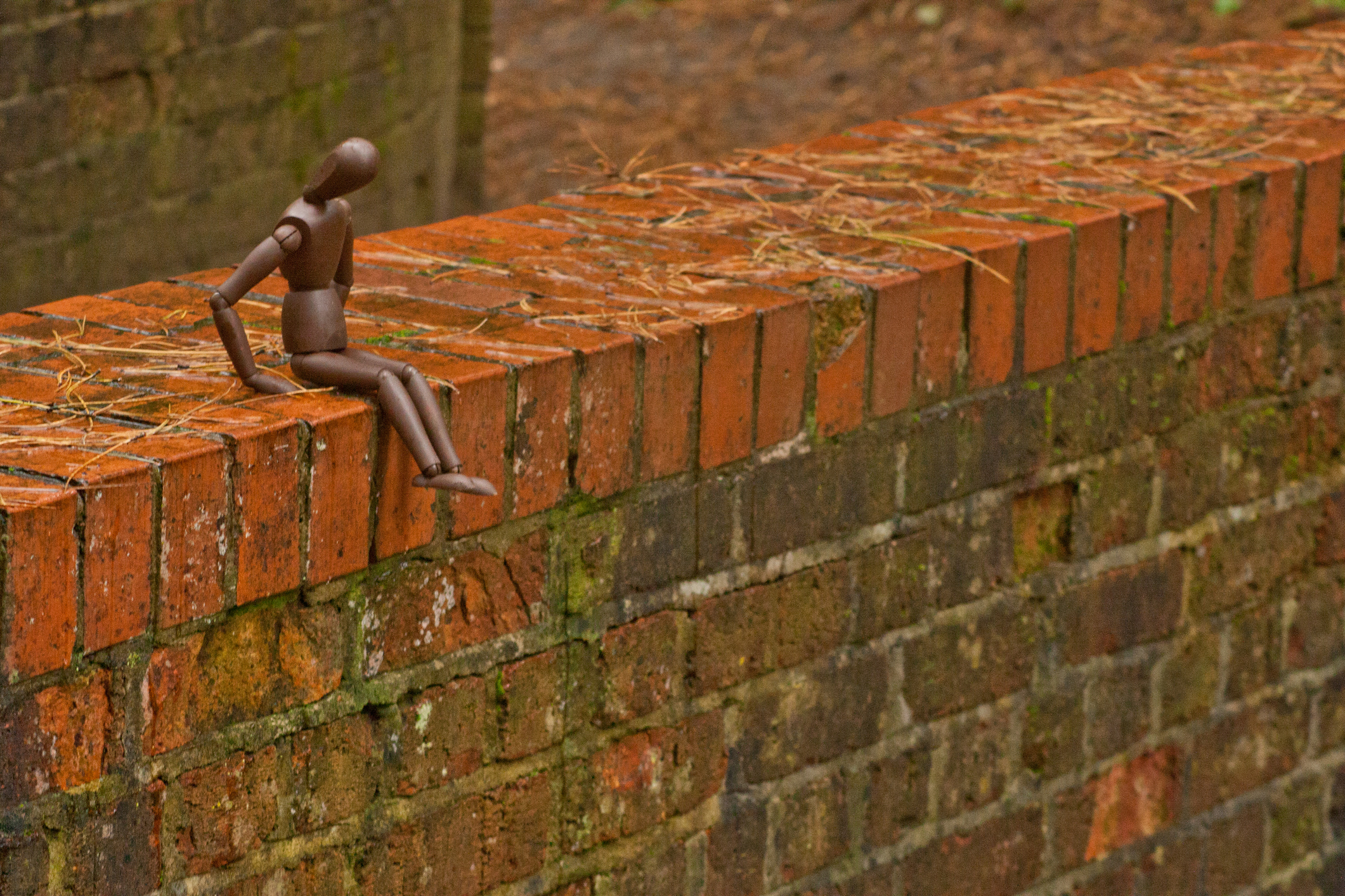 A mannequin person stands precariously on the edge of a bridge edge with bad thoughts. The possibility of committing suicide.