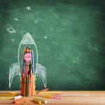 Start School Concept - Rocket Drawn On Blackboard