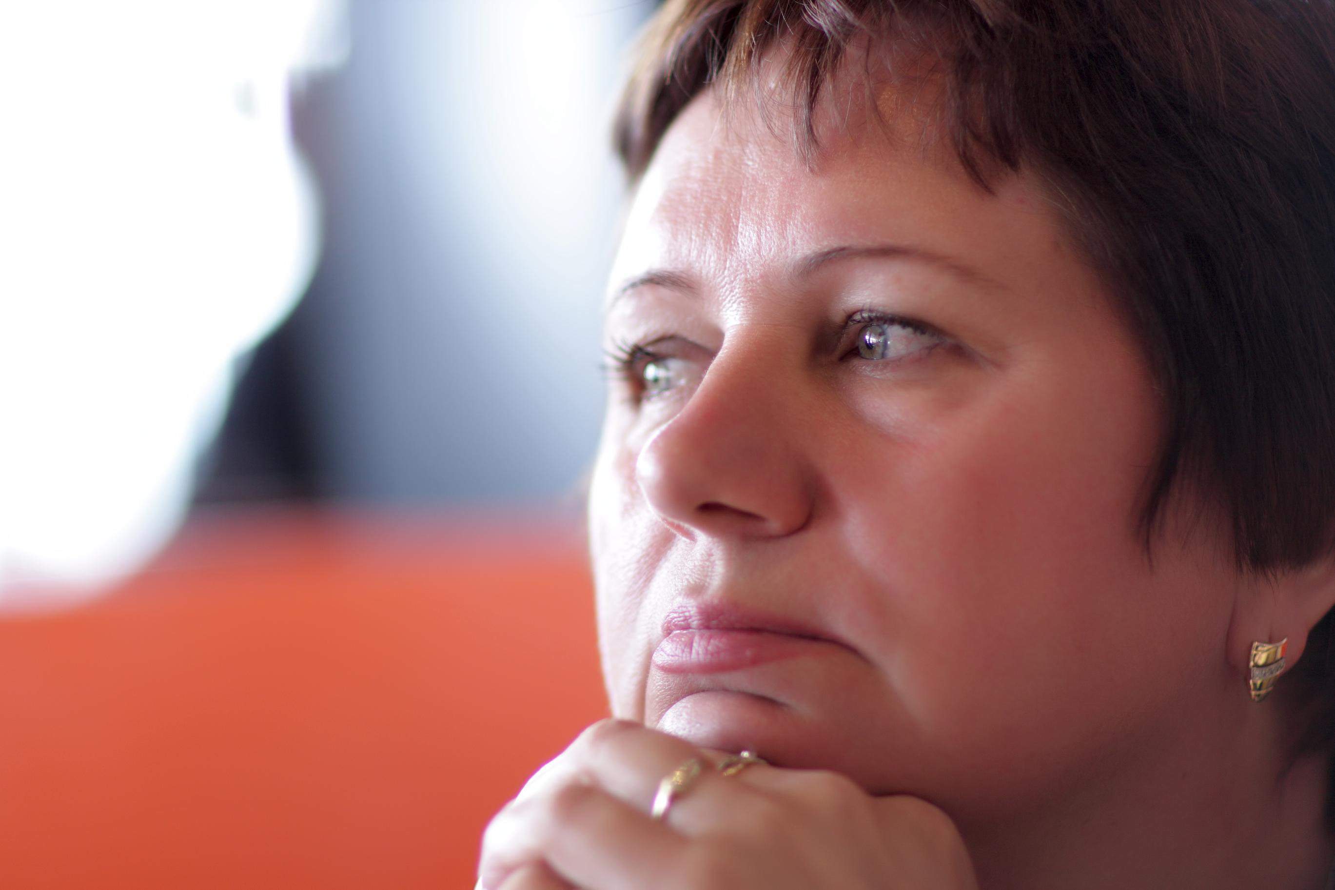 It is portrait of pensive mature woman indoor